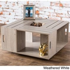 This square coffee table inspired by artisan wine bottle crates combines elegance with practical function. The four open shelves easily hold your books and knick knacks, while the stylish top with key