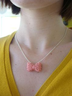 Cute little knit necklace... If only I could knit!  I'd make one in about 10 different colors.