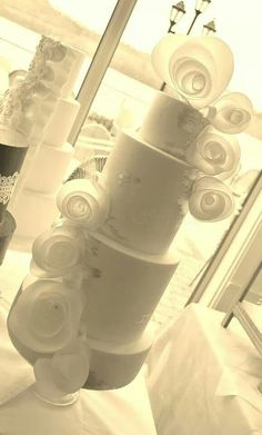 Wedding cake with wafer paper flowers and edible silver leaf