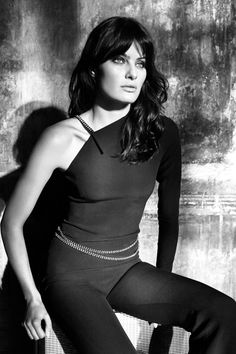 Isabeli models one sleeve jumpsuit