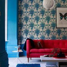 Turquoise backdrop: Love the bold color choices, amazing wallpaper, and butterfly print!