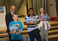 McGehee Elementary students getting books on the built environment donated by Heifer International