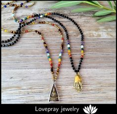 Our fine faceted gemstone Buddha and Mudra pendant necklaces are finally back in stock! Tiny genuine gemstones paired with super tiny hand made brass African trade beads, make for a delicate, boho chic, balancing combination! Chakra Jewelry, Yoga Jewelry, Cute Jewelry, Tassel Necklace, Pendant Necklace, Necklaces, Diffuser Jewelry, African Trade Beads, Gemstone Bracelets