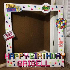 Polaroid photo booth Totally 80's birthday party. Material used cardboard, white paint, free online images printed at home, pom-poms from dollar tree.