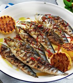 Sardines with chilli, garlic and lemon Let your summer sizzle with this gorgeous BBQ sardine recipe - packed with chilli, garlic and lemon, it is light, healthy and zingy. Easy Bbq Recipes, Fish Recipes, Seafood Recipes, Cooking Recipes, Healthy Recipes, Fish Dishes, Seafood Dishes, Fish And Seafood, Seafood Bbq