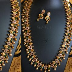 Stunning long haaram with flower design. Long haaram stuudded with multi color stones. Necklace with pumpkin hangigns. Indian Wedding Jewelry, Bridal Jewelry, Gold Jewelry, Beaded Jewelry, Jewelery, Indian Jewellery Design, Designer Jewellery, Jewelry Design, Gold Jhumka Earrings