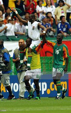 Golden goal scorer Henri Camara of Senegal celebrates with team mates Amara Traore and Papa Bouba Diop after the Sweden v Senagal, World Cup Second Round match played at the Oita Big Eye Stadium, Oita, Japan on June 16, 2002. Senegal won 2-1 after extra time.