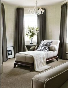 Window Treatments - Sitting room with soothing drapes in gray.