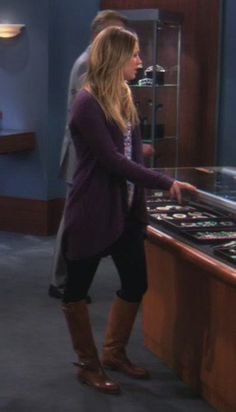 Penny's purple cardigan and brown boots on The Big Bang Theory. Outfit Details: https://wornontv.net/793/ #TheBigBangTheory