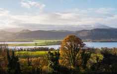 """Lower Lough Macnean to Cuilcagh Mountain. Thirty percent of Fermanagh in Northern Ireland is covered with lakes and waterways, and there are some 150 islands to explore here. The landscape has been called a glorious """"patchwork quilt"""" of woodland, forest, parkland and wetland."""
