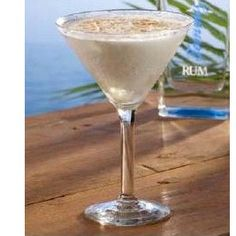 Coconut Cloud Martini 1 part Tommy Bahama White Sand Rum 1 1/2 parts vanilla vodka 1 1/2 parts coconut rum 1/2 part cream of coconut Toasted coconut for garnish