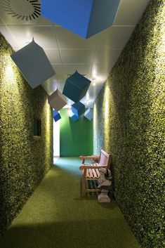 Astro turf walls and floor to create an indoor hedge