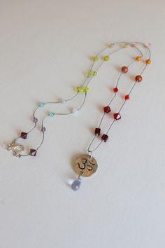 ombre chakra necklace. grey silk cord.