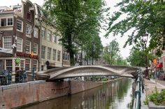 Long-awaited 3D-printed stainless steel bridge opens in Amsterdam Printed Concrete, Amsterdam Red Light District, Steel Bridge, Amsterdam Canals, Bridge Design, Pedestrian Bridge, Properties Of Materials, Steel Structure, Built Environment