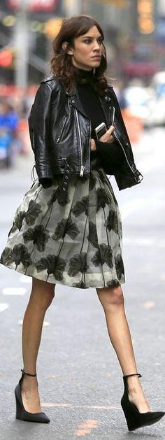 black coat, floral skirt and black shoes