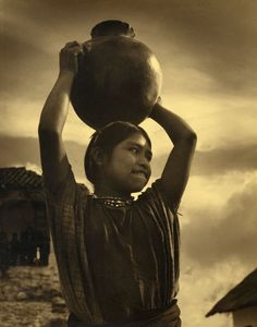 Girl with jar, South America, circa 1940. Silver print of the time.