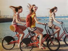 Three friends riding bikes by the ocean. Biking makes memories, adds to your love life, and helps you have fun.