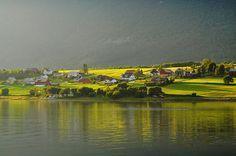 Isfjorden in low, evening sun. North of Åndalsnes, Norway