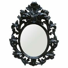 """Baroque-inspired wall mirror in glossy black.     Product: Wall mirror       Construction Material: Resin and mirrored glass    Color: Glossy black    Features:   Hand-detailed   Oval framed  Sleek beveled mirrors  Contemporary design      Dimensions:  Mirror: 24"""" H x 20"""" W  Overall: 43"""" H x 32"""" W"""