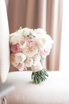 Bridal bouquet in soft pastels with Tulips, Lisianthus, Garden Roses and Spray Roses // Photography: Table4 Weddings - table4weddings.com