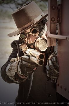 amazing steampunk cosplay design.  I can't decide if i like the face mask or gloves more.