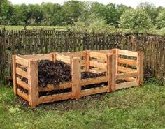 3 compartment compost bin. One finished, one decomposing, and one new material. Accessed by removable slats for dumping and turning.