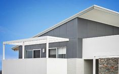 Another example of what I think amrish means. this is the cladding on top with brick below Budget Architect Designed Home House Cladding, Wall Cladding, Garage Exterior, Exterior Paint, Case Study Design, External Cladding, Front Fence, House Exteriors, Home Reno