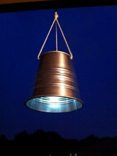 diy solar lantern. disassemble a dollar store solar light and put top onto pail
