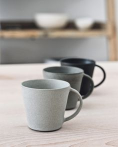Handled cups by Jono Smart