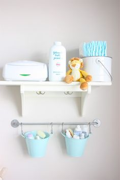 changing table organization, love the pails hanging on the wall IKEA! CONVENIENT!