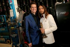 Jim Carrey and best Supporting Actor winner Jared Leto speak backstage during the Oscars held at Dolby Theatre on March 2, 2014 in Hollywood, California.