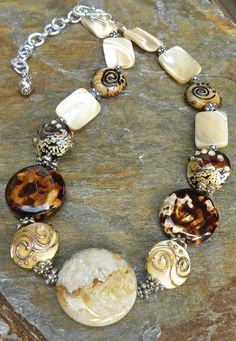 Fossil Coral focal with artisan crafted lampwork beads,Leopardskin Fire Agate,Natural Mother of Pearl and Bali sterling silver Clay Jewelry, Jewelry Crafts, Beaded Jewelry, Jewelry Necklaces, Jewlery, Wire Bracelets, Silver Necklaces, Diy Necklace, Necklace Designs