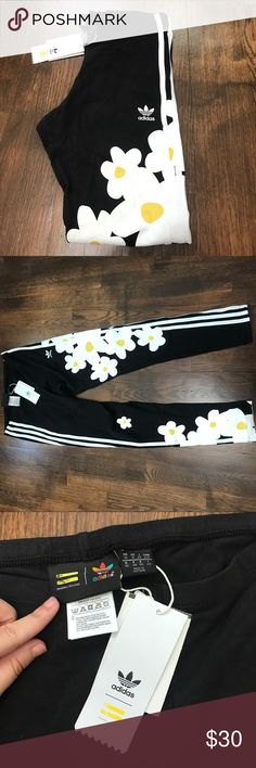 Adidas by Pharrell Williams leggings Brand new with tags. Super cute with the iconic stripes down the sides and fun flowers on them! Size small. adidas Pants Leggings