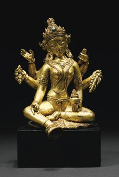A GILT-BRONZE FIGURE OF VASUDHARA, NEPAL, 15TH CENTURY                                                                                                                                                      More