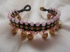 A personal favorite from my Etsy shop https://www.etsy.com/listing/121033705/pink-tourmaline-woven-dark-brown-waxed