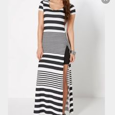 Striped side split maxi dress Black & white stripe maxi with double side splits✅ PRICE FIRM ✅ BUNDLE & SAVE  ✅SHIPPED SAME OR NEXT DAY ❌TRADES ❌PAYPAL Dresses Maxi