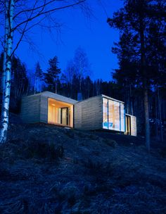 "The cabin's exterior walls and roof are clad in overlapping stone plates that mimic the look of traditional wood paneling found in Western Norway. ""It provides an affinity with the cabins nearby,"" partner and architect Nils Ole Bae Brandtzæg explains. Solar panels cover the chimney pipe, lighting LED lamps inside."