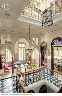 Moroccan-style townhouse. Not Caribbean, but look at the use of colour!!