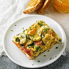 """Four-Cheese Zucchini Strata Strata simply means """"layers."""" This dish features luscious layers of garlic focaccia, sauteed zucchini, and four wonderful cheeses."""