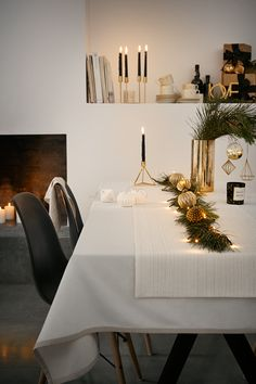 Take cues from the minimalistic design trend using pared-down patterns, high-shine metallics and neutral hues.   H&M Home