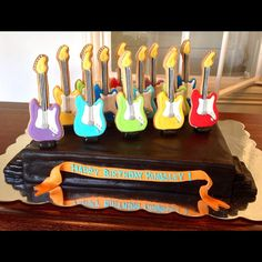 Guitar cookies on a chocolate cake stage for the rockstar birthday! - Baby Bea's Bakeshop