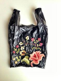 Nicoletta de la Brown embroiders plastic grocery bags