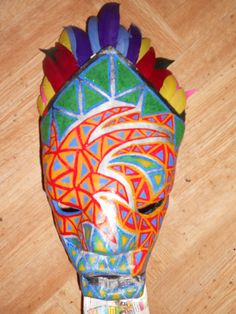 mask made in papier mache, paint in acrylic and glitters