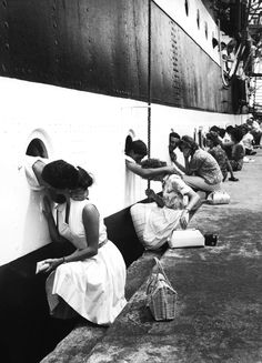 """In wives say goodbye to their loved ones in the Navy."