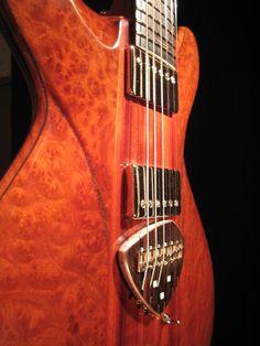 Goldorak-African padauk and camphor wood burl top    Thierry André, luthier.