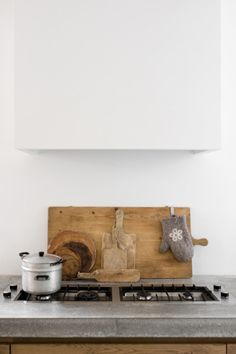 Case the range hood all the way to the ceiling (first need strong box to hold it; make casing lightweight and removable for access; needs several notches for molding, vent, stair bumpout)
