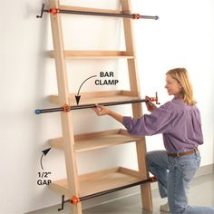 DIY Leaning Tower of Shelves. I see these all the time on Pottery Barn and absolutely love them.