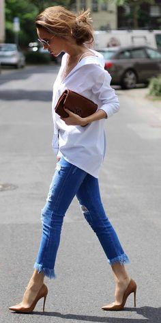 Alexandra Lapp + smart and sophisticated + fringed denim cut offs + white button down shirt + beige stilettos + simplistic leather clutch bag.   Jeans: Zara, Shirt: Steffen Schraut, Bag: Chanel. Spring Style.