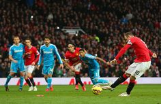 Wayne Rooney of Manchester United scores the opening goal from the penalty spot during the Barclays Premier League match between Manchester United and Sunderland at Old Trafford on February 28, 2015 in Manchester, England.