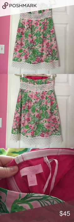 Lilly Pulitzer Tigerlily Dress This dress is classic Lilly- super fun print with tigers and Lilly flowers throughout and perfect pink and green color combo. The lace detailing pulls everything together. This dress is freshly dry cleaned and only worn a handful of times. Full boning in bust area as well. Lilly Pulitzer Dresses Strapless